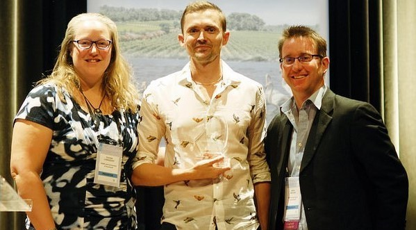 Photo Mike Hoffman accepted the DSA on behalf of IUCN Red List Committee at ICCB 2015.